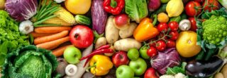 A beautiful rainbow of different fruit and vegetables in a pile.