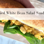Super simple curried white bean salad sandwich takes only 5 minutes and is delicious and nutritious! Make ahead and take for work lunches | created by calgary top registered dietitians at Ignite Nutrition Inc for the Husky Wellness Fair