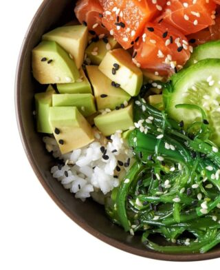 Healthy poke bowl with avocado.
