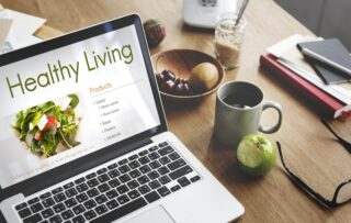 A healthy diet plan at a workplace computer - employee health benefits with a dietitian